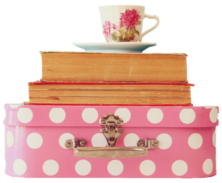 Suitcase with books and tea cup